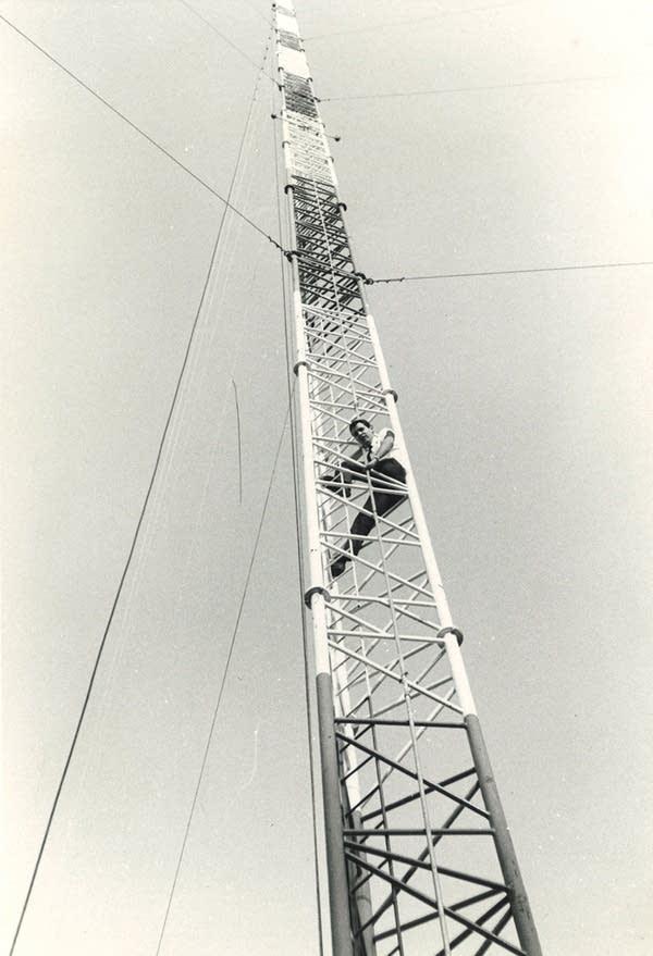 Bill Kling climbing the tower at KSJR's first transmitter site.