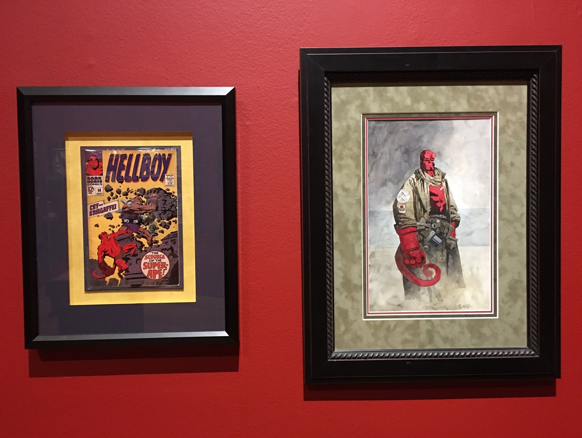A 'Hellboy' comic and drawing on display in 'At Home with Monsters'