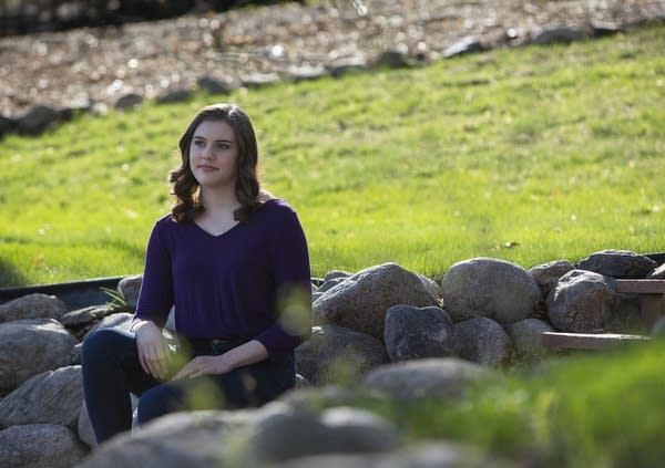 A woman sitting outside