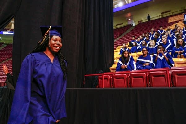 Diamond Syaz walks to her seat at commencement.