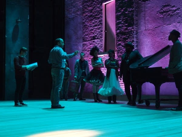 Artistic Director Peter Rothstein leads rehearsal.