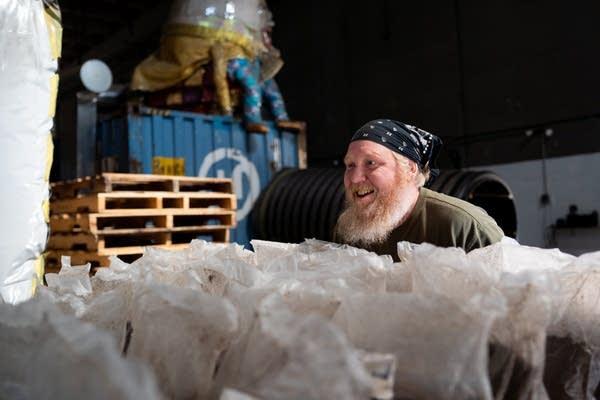 Mississippi Mushrooms employee Jason Lund pushes a pallet.
