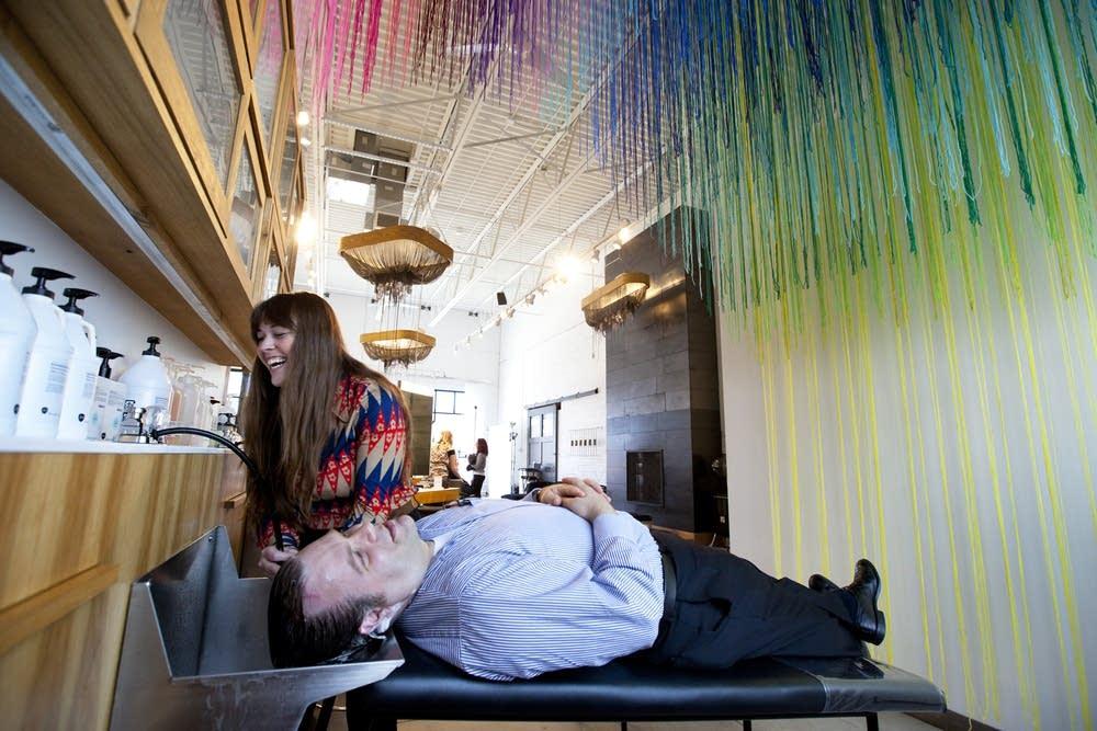 Caitlin Dvorak washes customer's hair