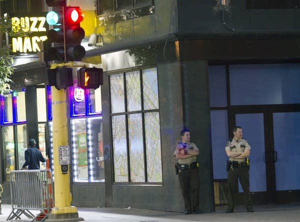 Officers watch the intersection of Hennepin Avenue and 5th St. No.