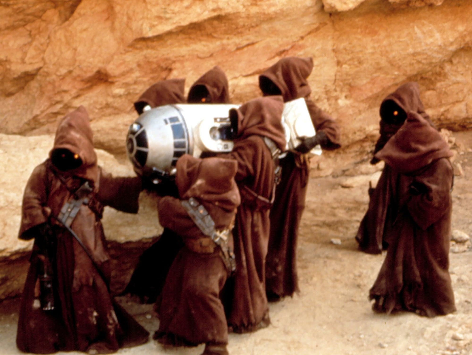 R2-D2 is carried by Jawas in 'Star Wars.'