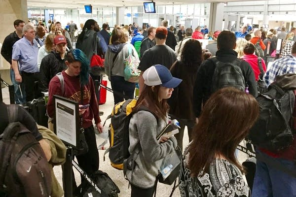 Travelers wait in line at MSP.
