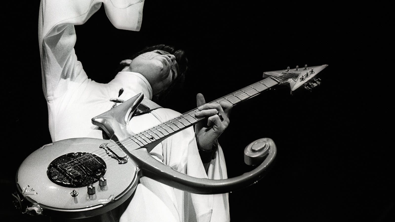 Prince on the iconic symbol guitar