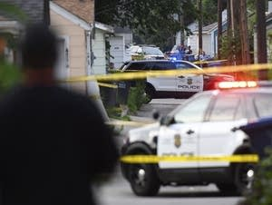 Police investigate the scene of an officer-involved shooting.