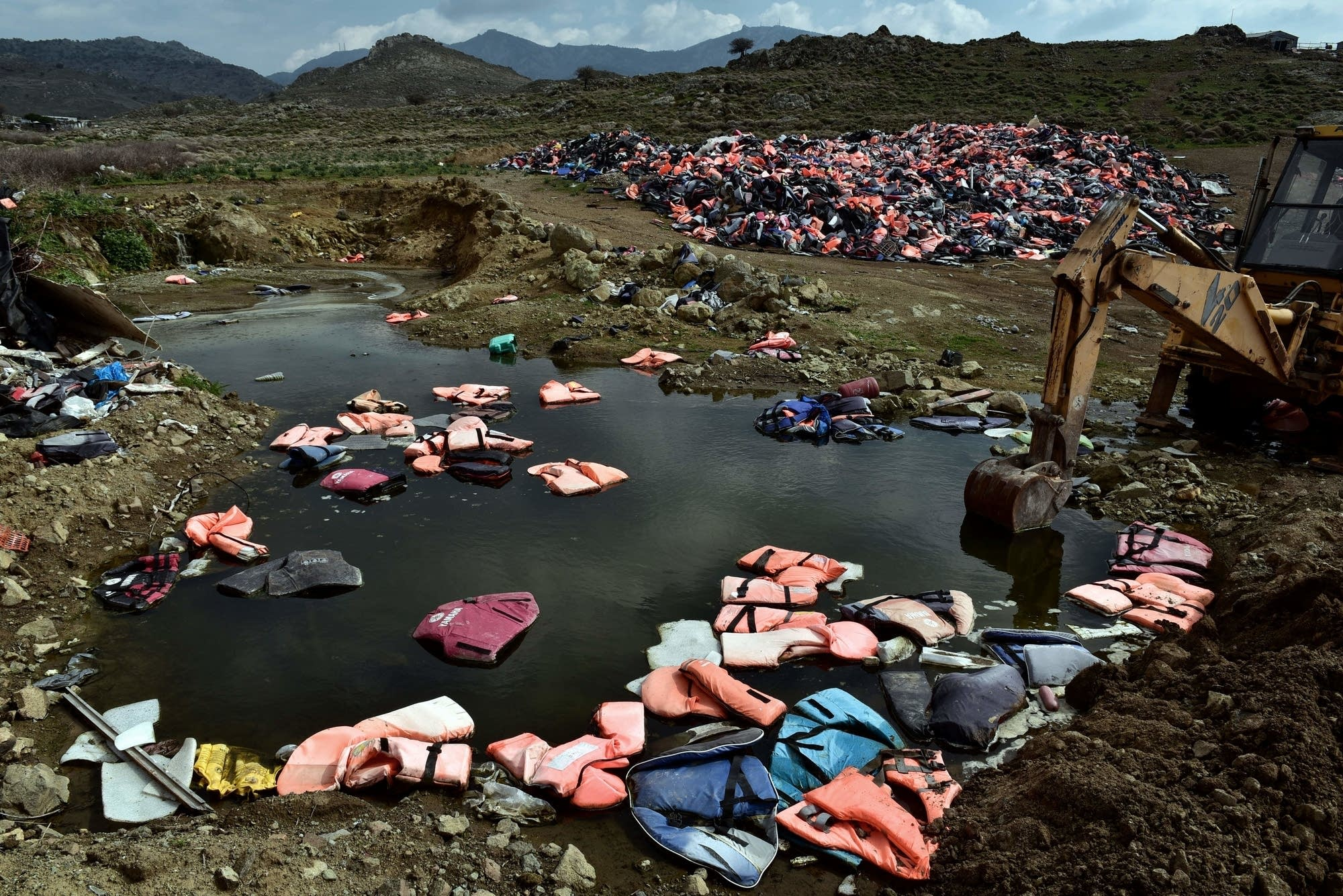 Piles of life jackets left by refugees who arrived on Lesbos lie at a dump.