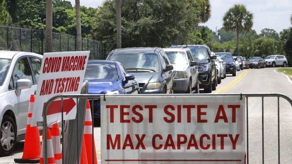 Cars line up at a COVID-19 test site