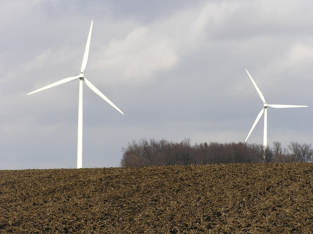 Wind turbines send electricity to an energy storage unit.