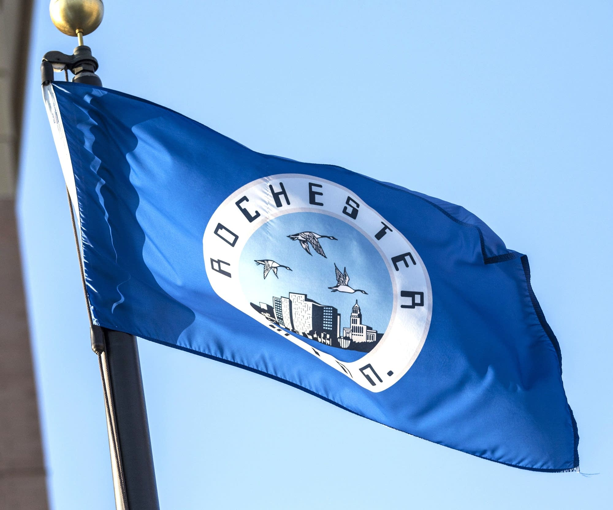 The Rochester flag flies at the City/County Government Center.