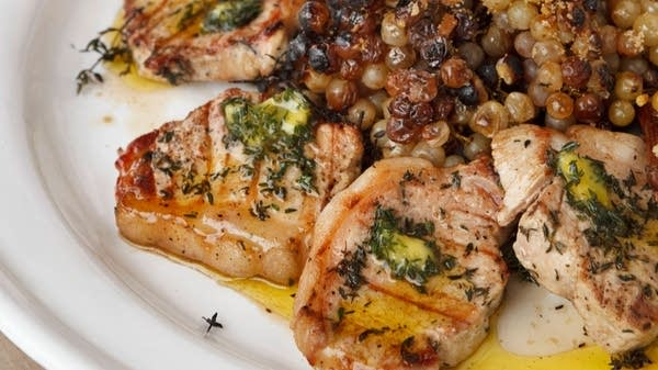 Pork Loin Chops with Thyme Oil and Roasted Grapes on the Vine