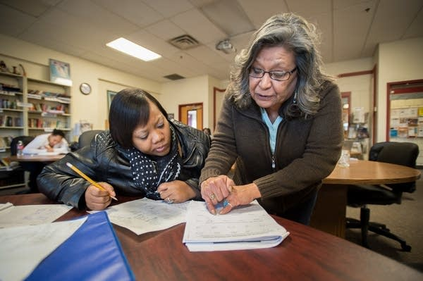 Darlene Barbour, right, helps Mykeisha Wright.