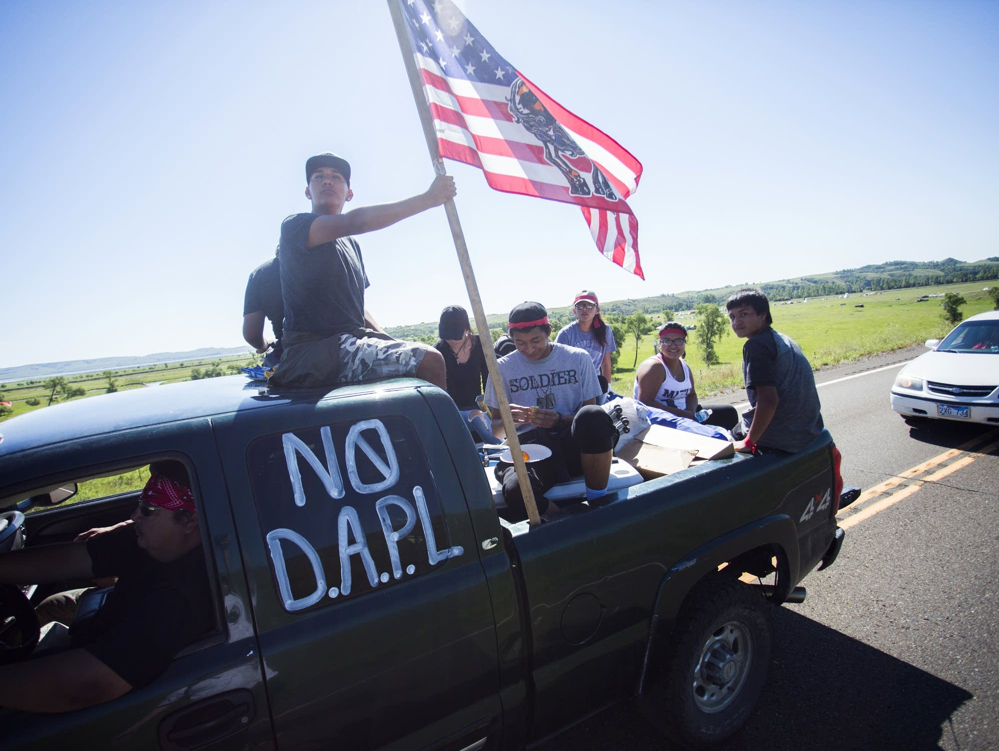 A car full of young people leave the camp.