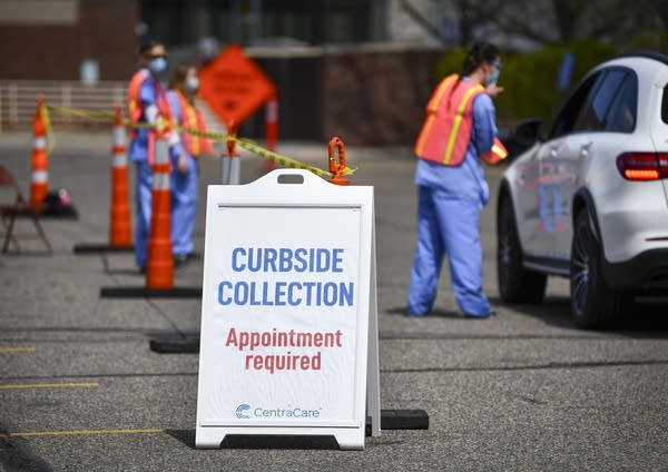 "A sign reads, ""Curbside collection. Appointment required."""