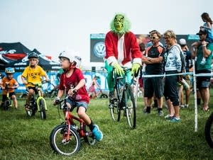 Alex Fortner, 5, rides with the Grinch.