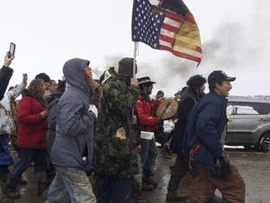 People peacefully leave the Dakota Access pipeline main protest camp Thurs.