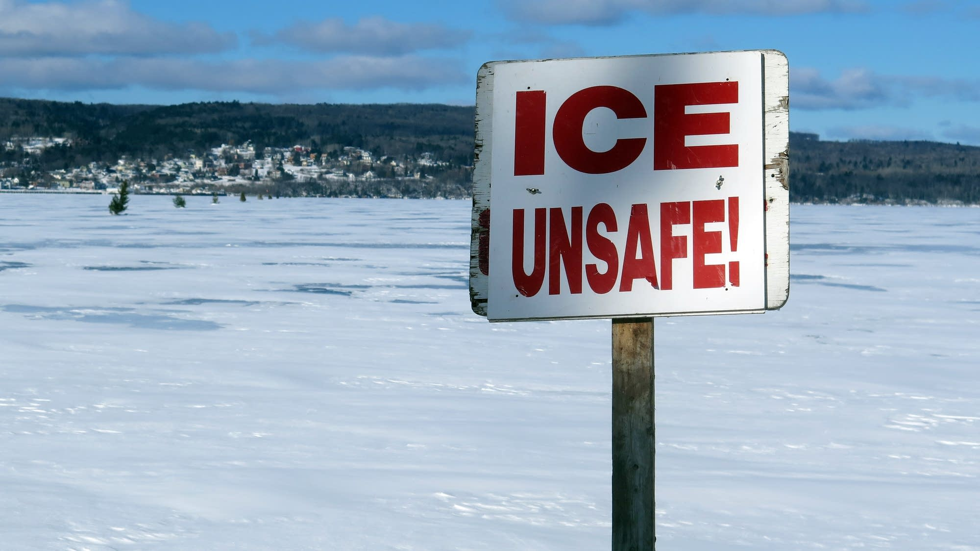 A sign  is posted where the ice road typically ends at Madeline Island.