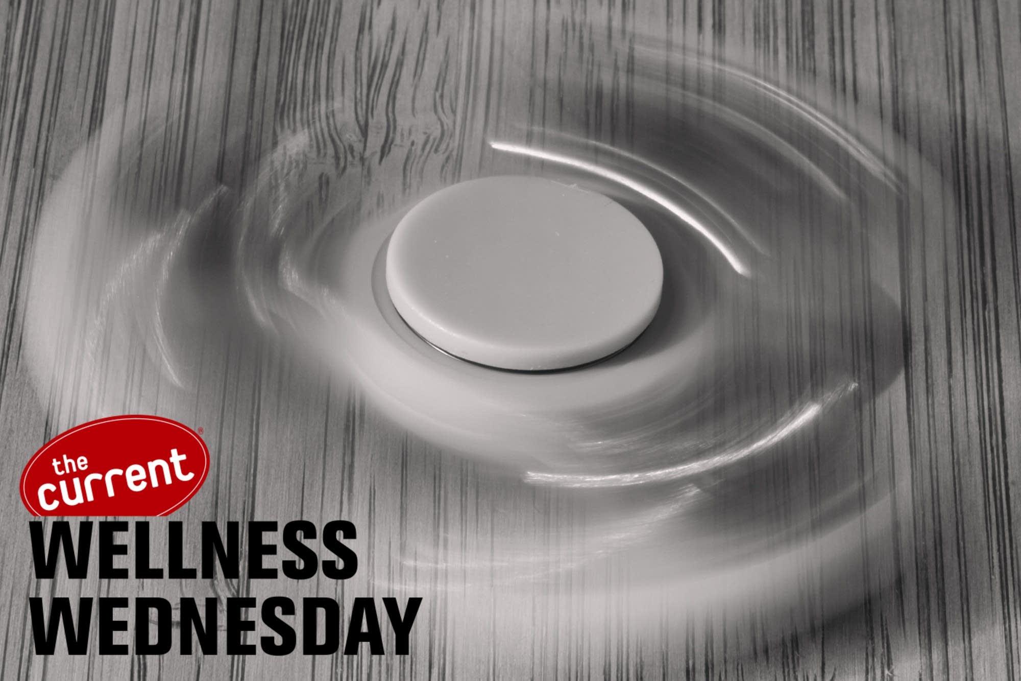 Black and white image of fidget spinner, motion blurred.