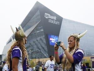 Fans take photos outside U.S. Bank Stadium.