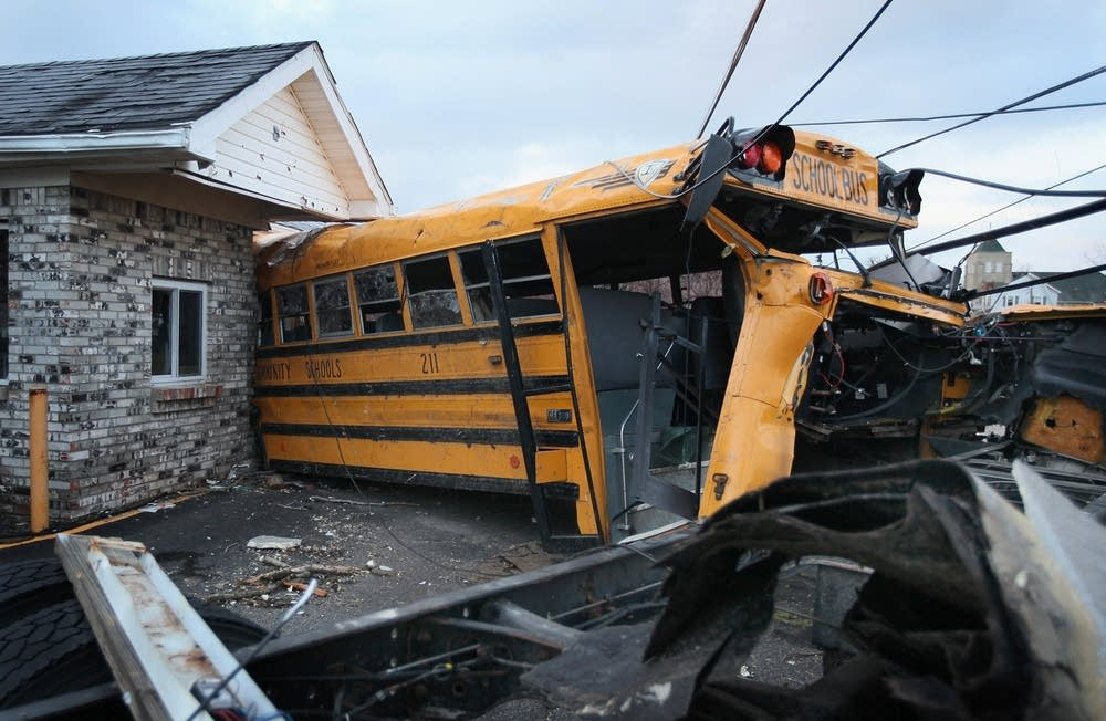 A school bus is lodged in a home