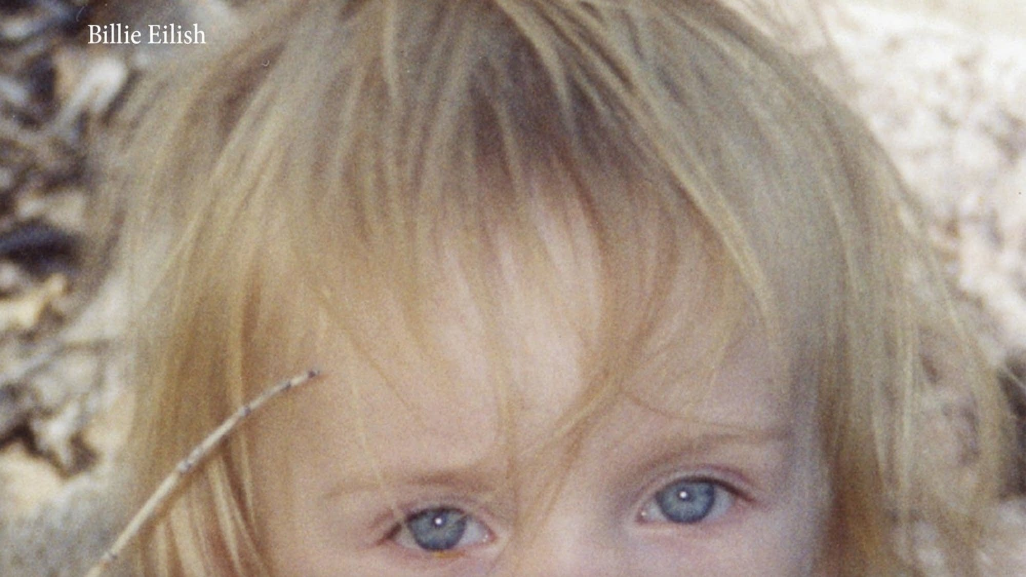 Billie Eilish book cover featuring the artist's eyes as a child.