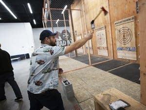 Minneapolis native John Dawson lobs an axe at Bad Axe Throwing.