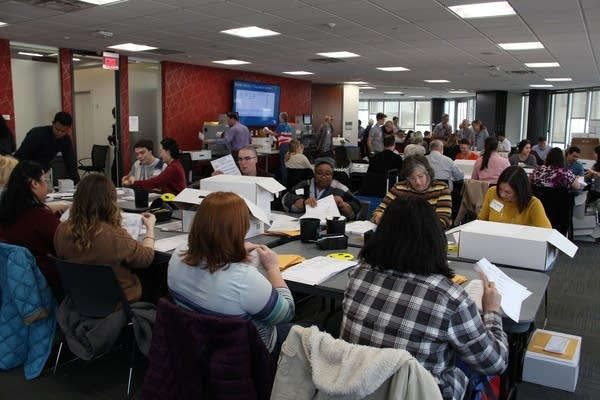 Volunteers count absentee ballots accepted in Hennepin Co. on November 1.
