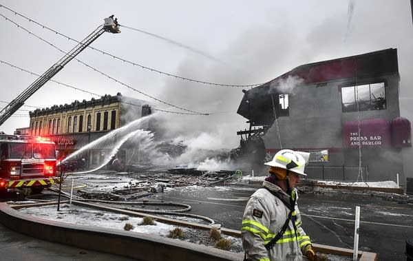 Smoke comes out of a destroyed building following a fire.