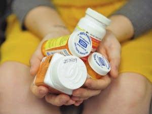 A handful of medication bottles
