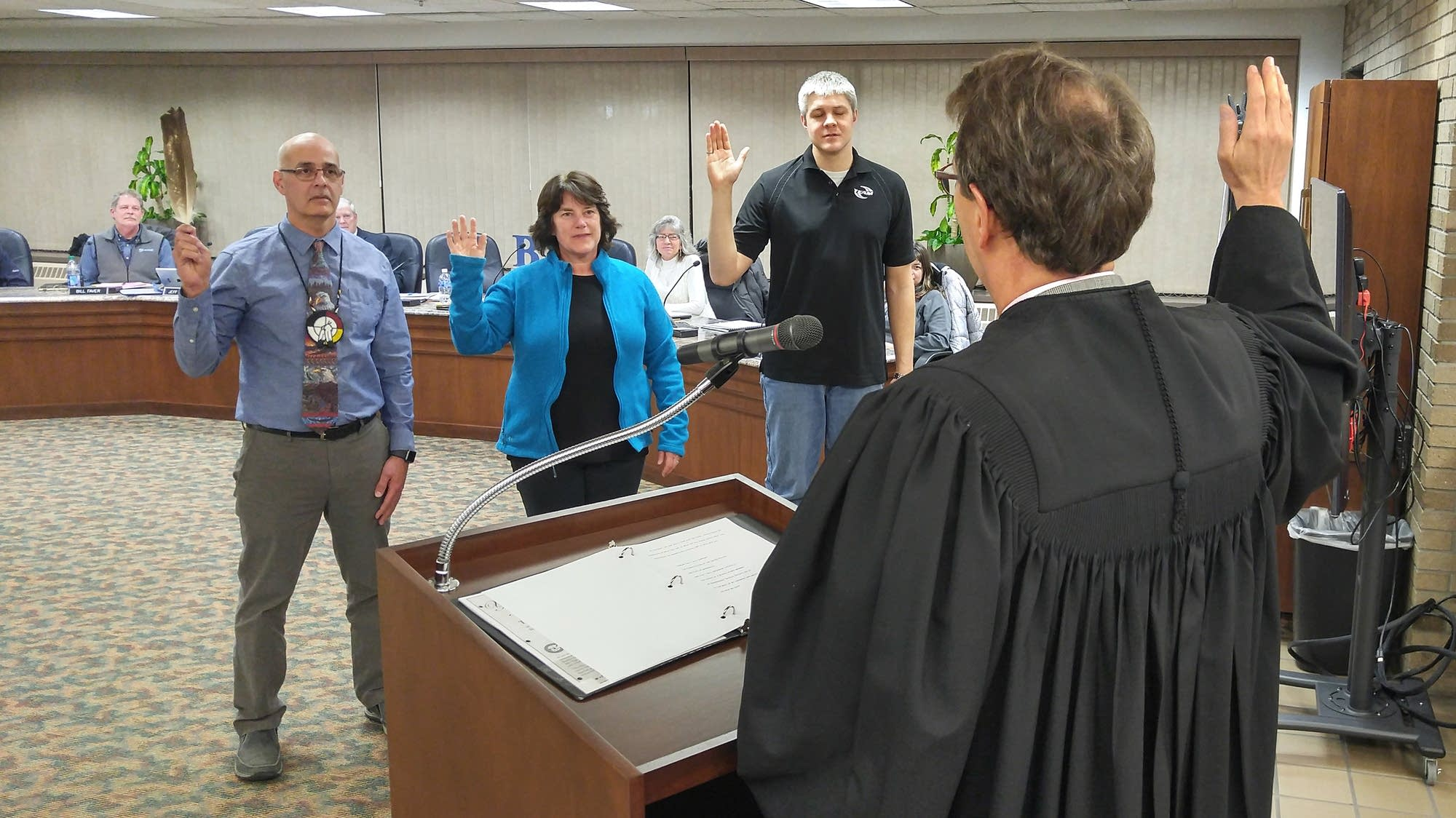 Judge Paul Benshoof swears in Bemidji Area Schools board members in Jan.