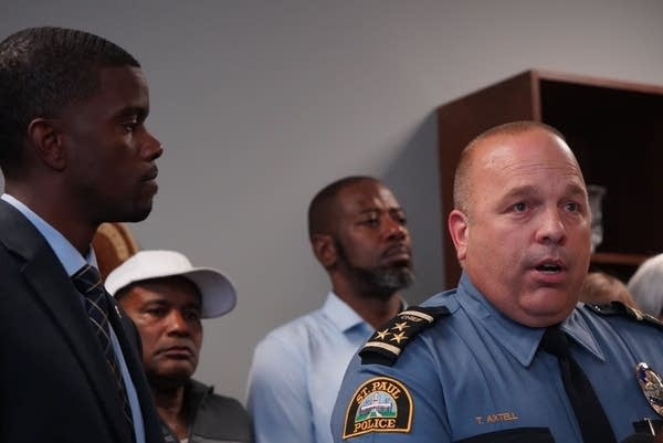 St. Paul Police Chief Todd Axtell next to Mayor Melvin Carter.