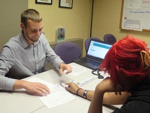 Daniel Schriemer helps a woman sign up for subsidized health insurance.
