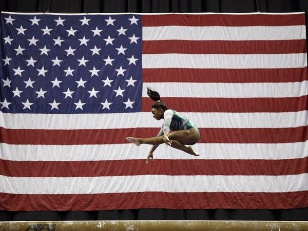 Simone Biles competes on the beam
