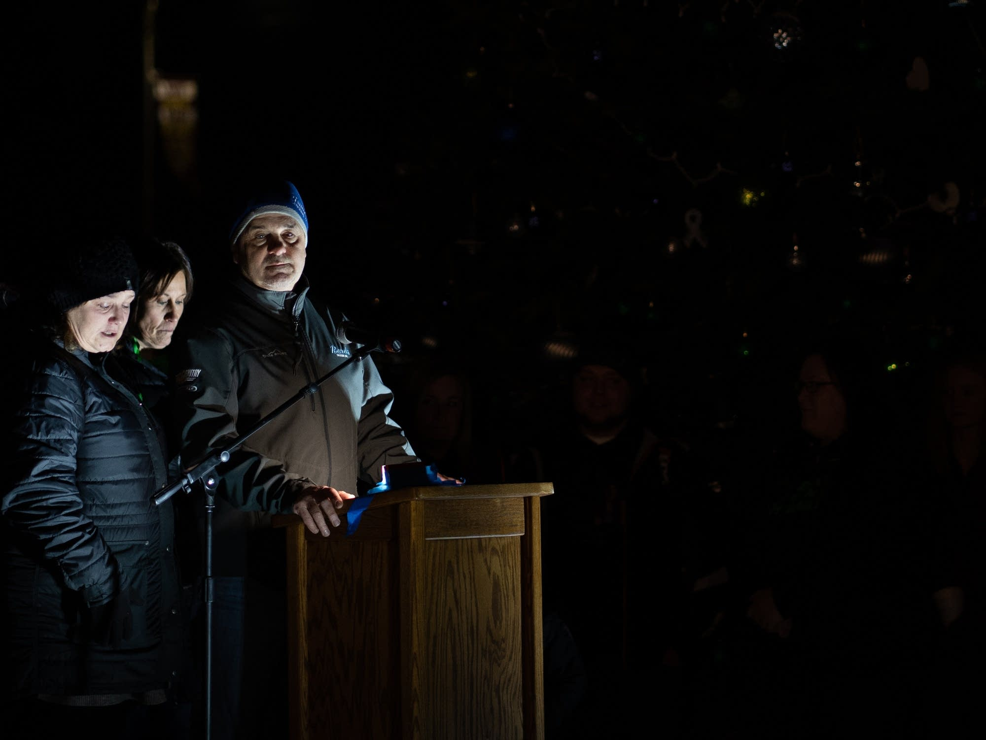 James Closs' brother, Mike Closs speaks at a tree lighting ceremony.