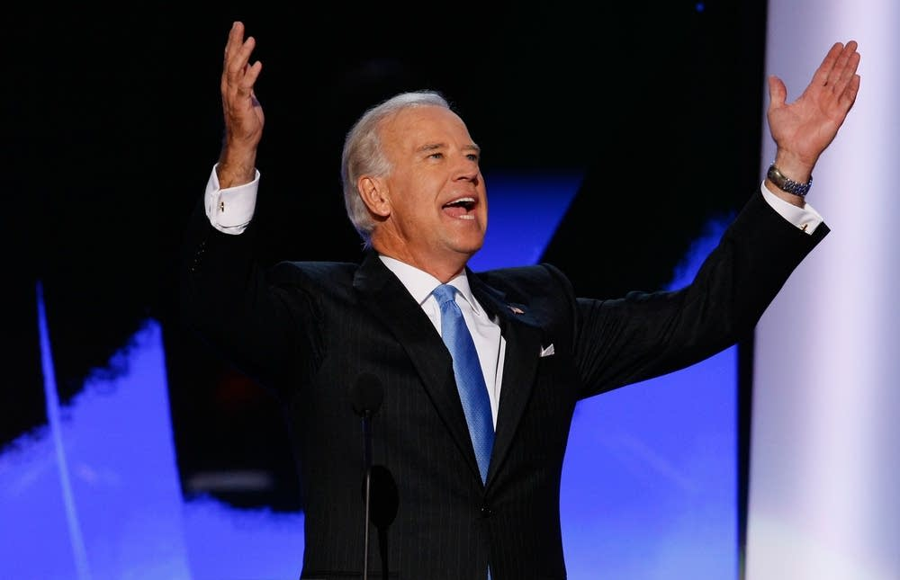 Joe Biden raises his arms at delegates at the DNC