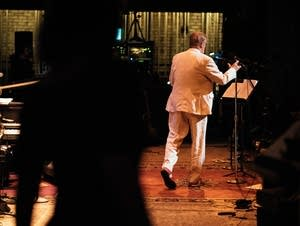 Garrison Keillor walks to the microphone for a show in his final season.