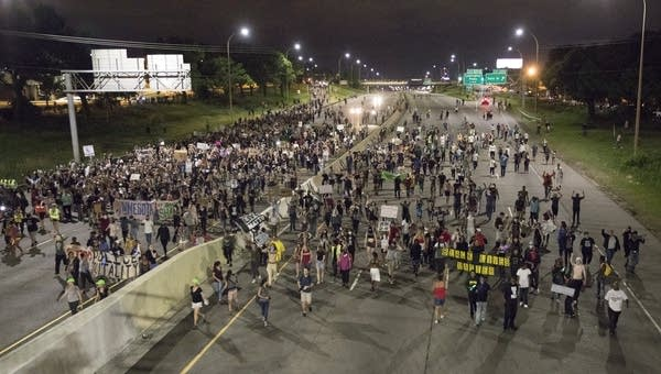Marchers shut down I-94 in protest of the Yanez verdict.