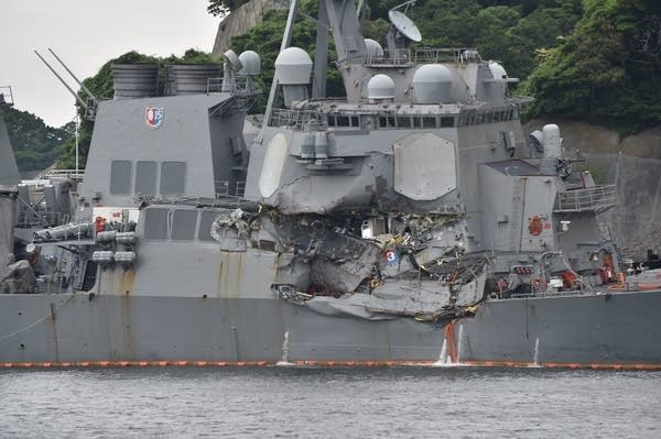 A number of missing American sailors have been found dead in flooded areas.