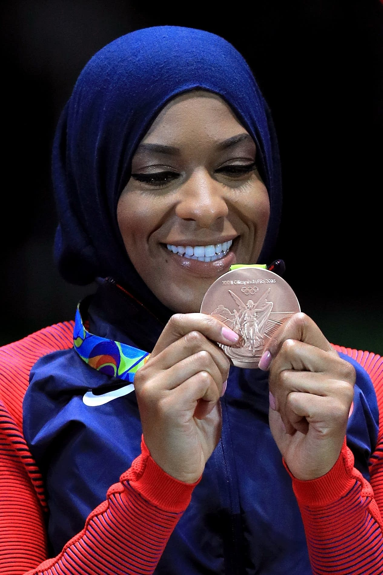 Bronze medalist Ibtihaj Muhammad of the United States celebrates.