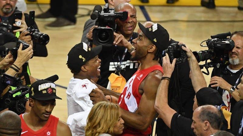 The Raptors' Kawhi Leonard and Kyle Lowry celebrate.