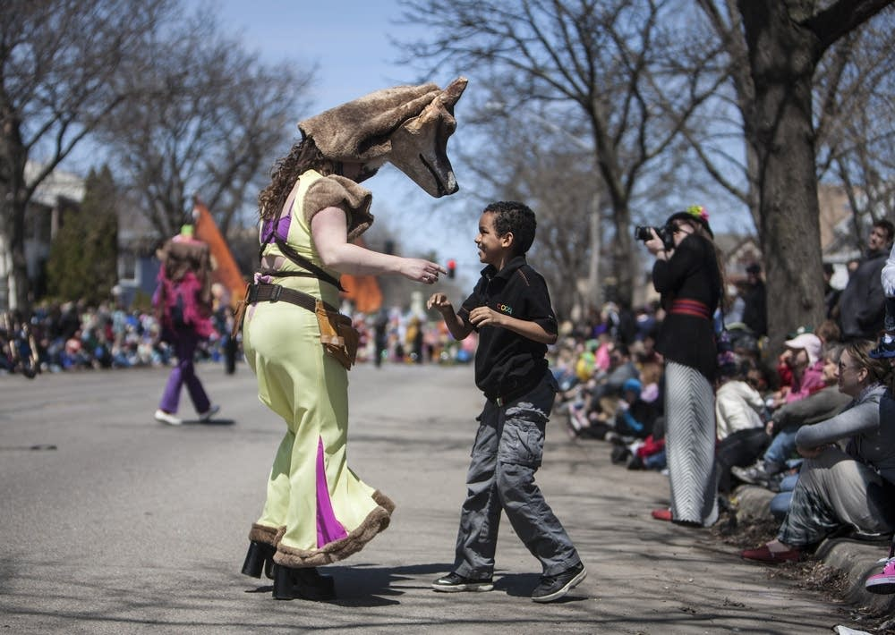 Isiah Ayala, 8, dances with a fox.