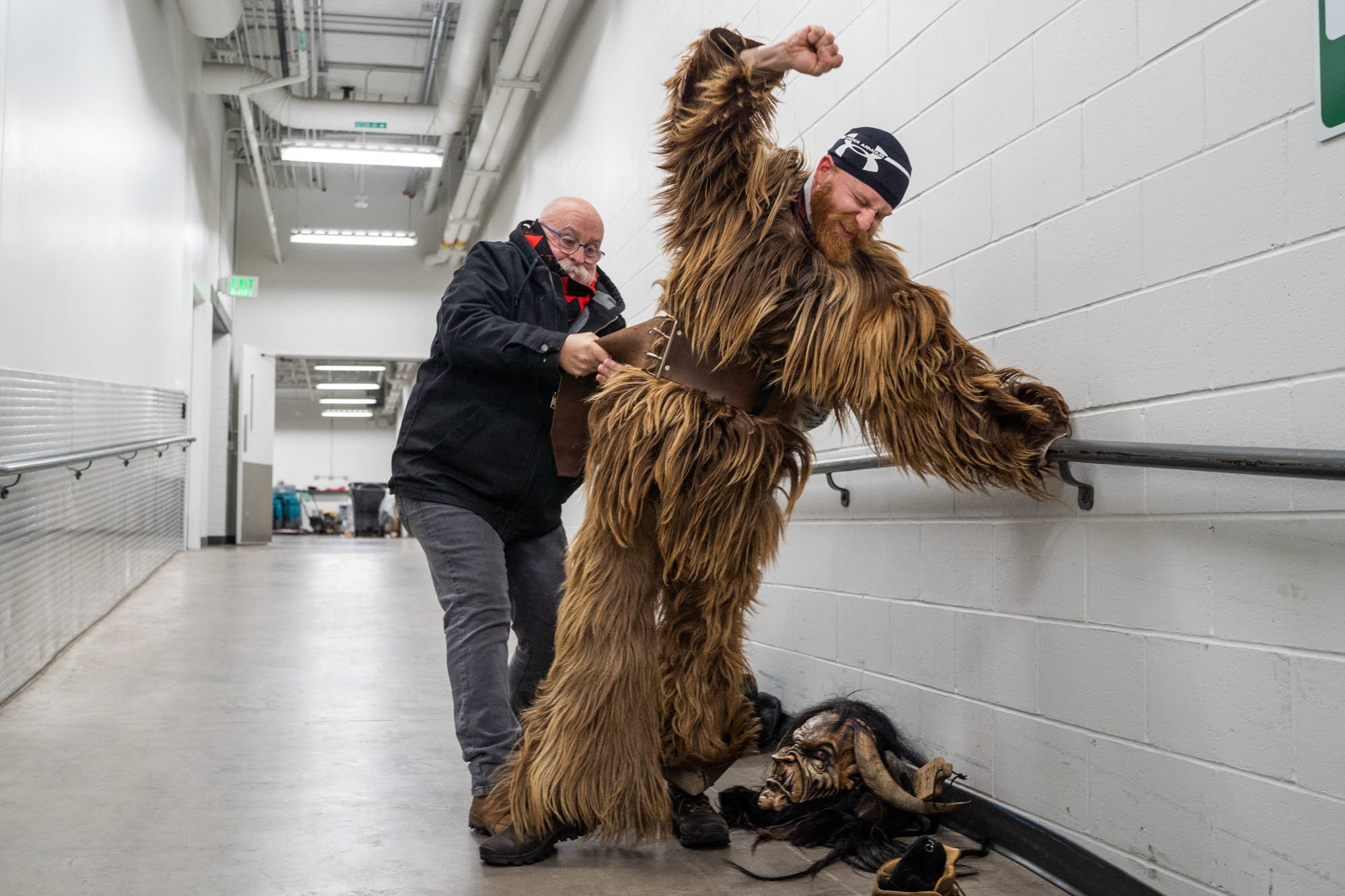 Mark LaCourse helps his son, Matt, into his Krampus outfit.