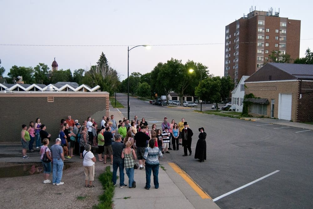 A group of about 50 people do the Ghost Walk.