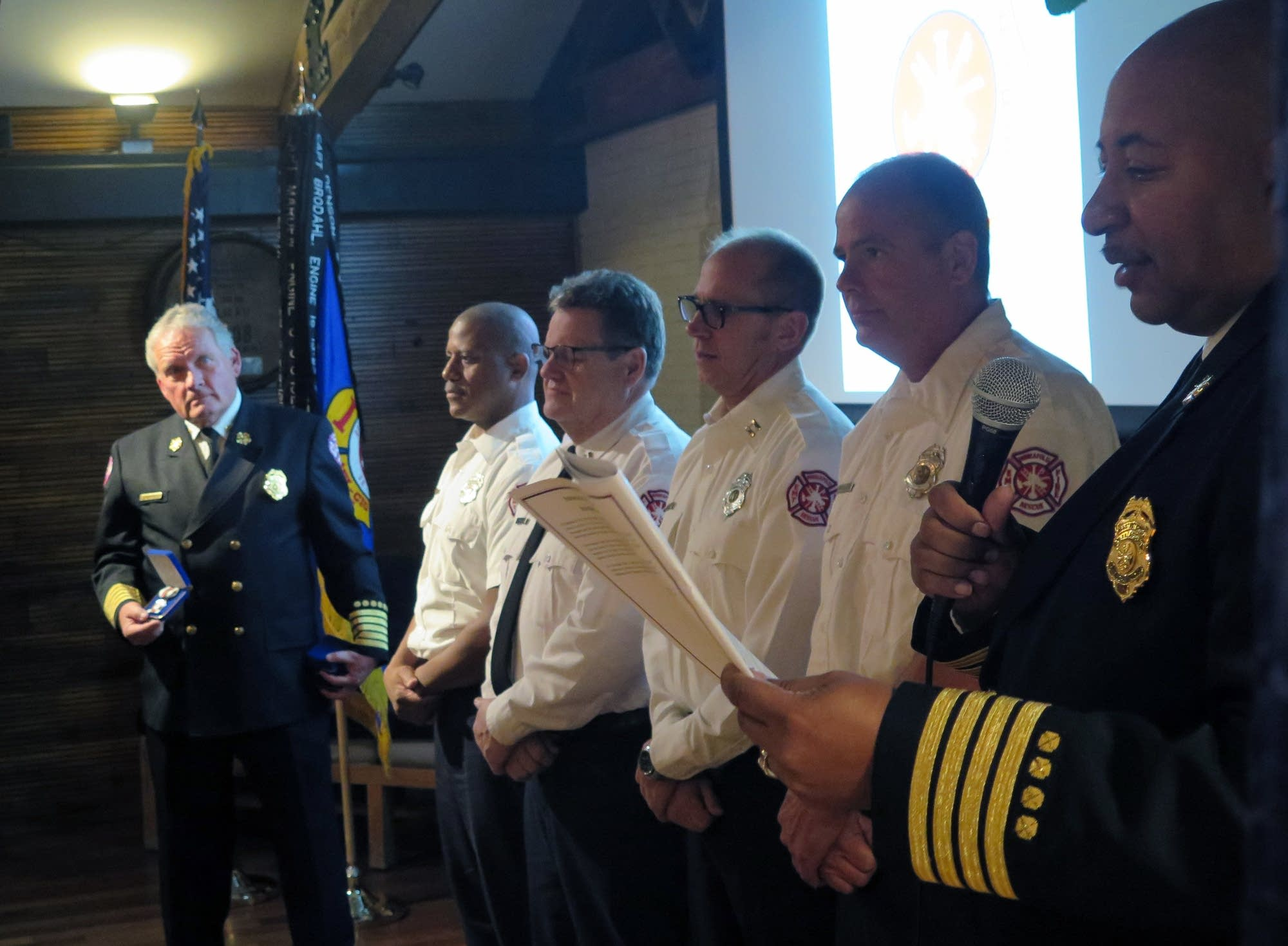 Firefighters honored for rescuing three men.