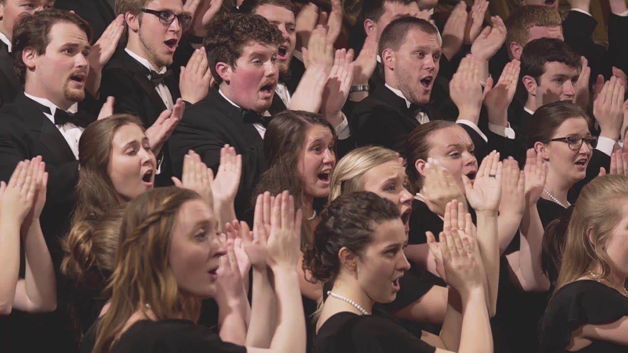 Choir with clapping hands