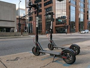 Bird scooters parked along Seventh Street in St. Paul.