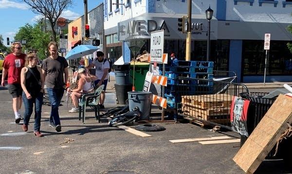 barricades block a road in Uptown Minneapolis