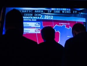 People watch the results roll in.